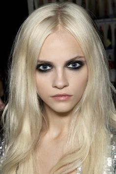 Going grunge glam | The disheveled beauty of the 90s is back this season, with dark eyes, smudged liner and don't-care hair.
