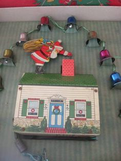 Vintage Christmas Santa Collectible ~ Tin Litho Santa Claus on Roof Bell Ringer by Criterion (The bells hang in the Christmas tree and the house sits underneath. Then the Santa pull the wire and rings the bell in the tree. So neat!)