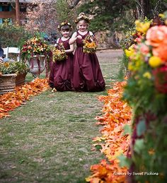 thinking about lining the aisle with fall leaves like this! Then having lexi drop leaves & rose petals