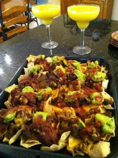 Loaded Supreme Nachos  This is a good Nacho recipe the thing I like about it is you can modify it to your liking