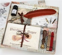Cute little starter set with sealing wax, three nibs, jar of black ink, and some parchment paper.
