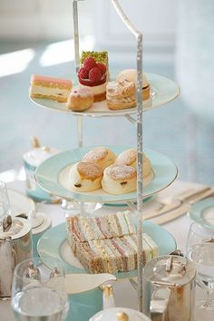 Afternoon tea: tiered server with pastries on top, crumpets in the middle, and sandwiches on the bottom. Heavenly treats!