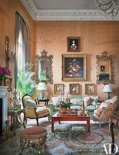 The ballroom features Mehle's collection of 18th- and 19th-century mirrors and paintings, which overlook a Chinese low table by Gracie, an 18th-century Italian bergère (at right), and a sofa whose pillows are made of Scalamandré floral prints