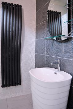 Another shot of the Wave White Metallic and Wave Grey Metallic 33.3x100cm wall tiles by Porcelanosa.