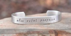 alis volat propriis - hand stamped bracelet - she flies with her own wings
