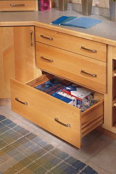 Use this three drawer base cabinet to increase the storage space in any room.