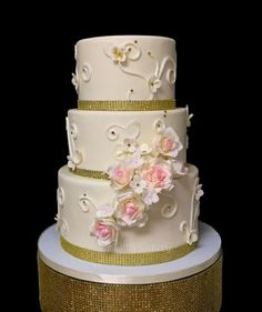 Gold and pink wedding cake with Sugar roses