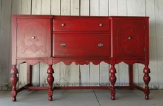 Red Quarts. This buffet is solid red, distressed and glazed with just a hint of shimmer. Drawer interiors have been freshly stained. Modern Vintage