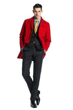 Navy pin stripe suit, red coat and yellow tie. Great look!