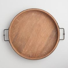 One of my favorite discoveries at WorldMarket.com: Round Rustic Wood Tray with Iron Handles