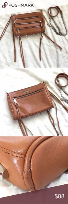 RARE Rebecca Minkoff 5 Zip Mini Mac Rare Rebecca Minkoff 5 Zip Mini Mac convertible cross body in brown.   A number of exposed zip pockets, two functional (one on front & one on back) and two for show, with fringe dangling from zipper pulls. Wear as a clutch or cross body. In gently used condition. Very, very minor wear pictured.   ~ Top Zip closure  ~ Silver tone hardware  ~ Optional studded chain strap ~ Top exterior pocket ~ Back exterior pocket  ~ Protective metal feet   SMOKE/PET FREE…