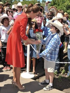Pin for Later: Kate Middleton and Prince William's Most Precious Moments With Kids  She was greeted by a cute little boy in a cowboy hat at the Calgary Zoo in July 2011.
