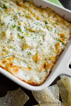 The BEST cheesy artichoke dip EVER!!!  It's made with three cheese and served hot.  |  mynameissnickerdoodle.com
