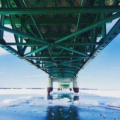 Blue ice under the Mackinac Bridge #Michigan #PureMichigan #travel