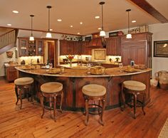 I'm not sure how I feel about this curved approach to second island/bar. It makes the kitchen feel like an amphitheater. But that could be a good thing if you sing or dance while you cook. I do sometimes.  It's an interesting use of space.    Do you like it?