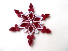 Decorative handmade Christmas stars in quilling technique, with an exquisite design. Varnished with varnish, which makes them resistant and