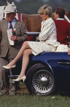 DIANA   Diana wore one of her quintessential puff-shoulder suits with matching ivory pumps to the Royal Ascot in the UK   June 1987