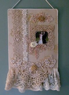 Using vintage and some new tea staned laces to create this wall hanging as a wedding gift.Start out with a backing of silk dupioni and layer it with a picture of the happy couple, add laces, beads and some silk ribbon.