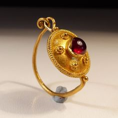 *ITALY ~ Roman Gold Earring, set with a cabachon garnet, dating to the Century AD Byzantine Jewelry, Medieval Jewelry, Ancient Jewelry, Antique Jewelry, Vintage Jewelry, Roman Jewelry, Jewelry Art, Gold Jewelry, Fine Jewelry