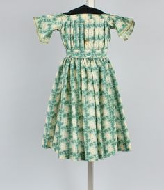 Dress, girl's, green and off-white wool challis, stylized square and foliage print, 1855-58