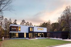 Architecture firm in situ studio, have designed a new modern house that's surrounded by the forest and overlooks a pond in Matthews, North Carolina.