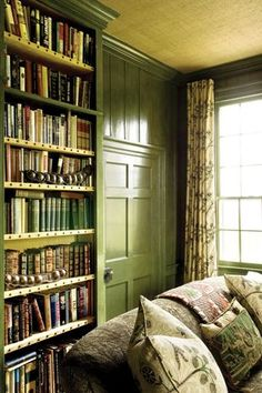 Green Farrow and Ball library + tape & nail head trimmed bookcases....