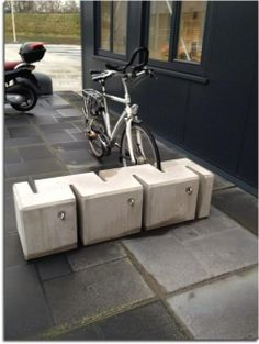 Integrating seating and bicycle storage allows the sidewalk to have multiple functions in a minimal amount of space. Concrete Furniture, Urban Furniture, Street Furniture, City Furniture, Cheap Furniture, Parking Plan, Bike Parking, Parking Design, Signage Design