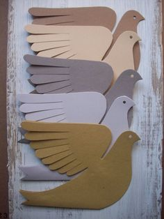 Very bird-like for paper! Each bird is cut from doubled cardstock. Five natural colors-two shades of brown, two of gray and a yellow green. The wings bend any way you like. A paper hanging loop is glued between the wings. Hang with string, ribbon or fishing line to make a mobile or just hang from the ceiling or a light fixture or curtain rod. Fasten to the wall to create a little flock of brown birds in flight. Each bird has feather-cut wings, a forked tail, a bird profile face with hole…
