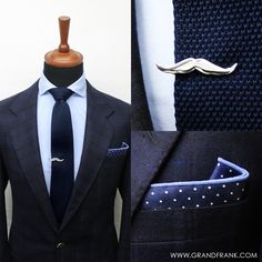 The navy blue knitted tie, mustache clip and a blue dot pocket square over the light blue Oxford shirt.