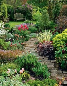 Like the diagonal pavers and full flower beds--flowers low enough they don't block the view, then a shrub at the corner to make the rest of the garden a secret.