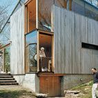 In 2005, Suzanne and Brooks Kelley hired Gray Organschi to renovate an old cottage on their property. The resulting 1,100-square-foot glass and ipe structure suited the sloped meadow perfectly. Photo by Mark Mahaney.