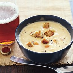 Slow cooker beer and cheese soup.Very delicious soup with Cheddar cheese,chicken broth and beer cooked in slow cooker.