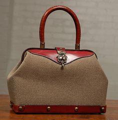 vintage Aigner doctor handbag. $55.00, via Etsy.
