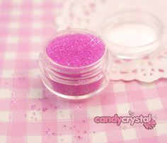 5ml pot of pink sugar faux sprinkles for decoden - £1.25  http://candy-crystal.co.uk/diy-deco-supplies/deco-sauces-glues/pink-sugar-deco-sprinkles-topping-for-decoration-of-miniature-sweets.html  SKU: 029