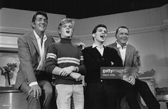Entertainers Dean Martin and Frank Sinatra with with their sons, Dean Paul Martin and Frank Sinatra Jr. on the set of 'The Dean Martin Show' Christmas special in 1967 in Los Angeles, California.