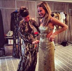 Giovanna Battaglia and Rosie Huntington-Whiteley prepping for the amFAR Fashion Show Tribute to Elizabeth Taylor