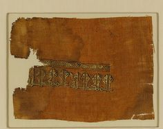 Textile Object Name: Fragment Date: 10th–11th century Geography: Egypt Culture: Islamic Medium: Linen, ink, gold; plain weave, block printed, painted Dimensions: Textile: L. 6 1/2 (16.5 cm) W. 8 3/4in. (22.2cm) Mount: L. 10 1/4 in. (26 cm) W. 12 1/2 in. (31.8 cm) Classification: Textiles-Painted and/or Printed Credit Line: Gift of George D. Pratt, 1931 Accession Number: 31.106.26