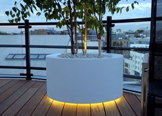 round white powder coated tree with an underneath in a terrace lighting y
