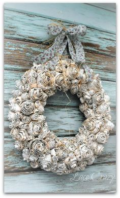 DIY Paper Rosette Wreath Tutorial. Paper wreath, rustic wreath, holiday wreath, rose wreath, farmhouse style, rustic style.