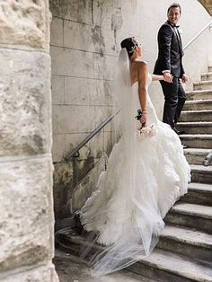 Mermaid-style Maggie Sottero wedding gown with organza rosettes and long train. #weddings #brides #grooms #weddingdress #bridalgown