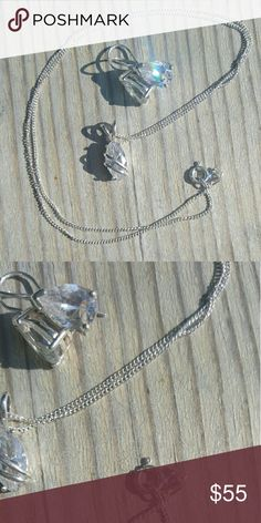 Sterling silver and Australian crystal pendant set Sterling silver and Australian crystal pendant and earrings set. Marked 925 silver,  large pear shaped crystals, 16 in chain included. Nwot. Urban Outfitters Jewelry Necklaces