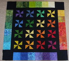Bright Pinwheels, beautiful rainbow quilt!