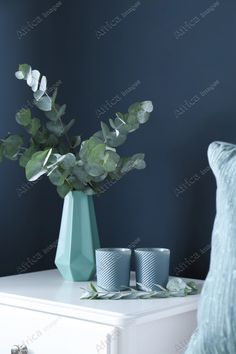 Beautiful eucalyptus branches and candles on white table near blue wall. Interior element. Buy Creativity & Imagination. Take a look at what the world's best photographers have to offer at africa-images.com Eucalyptus Branches, Best Photographers, Blue Walls, Glass Vase, Africa, Candles, Stock Photos, Creative, Interior