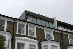 roof extension using minimal windows as the facade