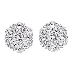 "Fleurette"" diamond cluster earstuds, with round-cut diamonds weighing approximately 1.94 total carats (D-E color/VVS1-VVS2 clarity), mounted in 18k white gold, numbered BL51204, signed VCA for Van Cleef & Arpels."