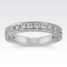 This exquisite band will have you looking at every angle to see every pavé-set diamond from the top and side to side. Surrounding the 88 round diamonds, at approximately 1.19 carat total weight, is lovely milgrain detailing. Each diamond has been hand-matched for consistent fire and brilliance and is crafted in quality 14 karat white gold.
