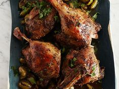 Slow-Cooked Duck with Green Olives and Herbes de Provence | This is the most forgiving and delicious duck recipe you'll ever find. Paula Wolfert slow-cooks duck with aromatics until it's as tender as confit, then crisps the skin. #Ducks