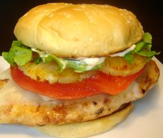 Red Robin Teriyaki Marinade 1 3/4 cups water 1 cup soy sauce 1 cup light brown sugar 1/2 teaspoon onion powder 1/2 teaspoon garlic powder  1 5-ounce skinless chicken breast fillet 2 canned pineapple slices 2 slices Swiss cheese 1 sesame seed hamburger bun 4 teaspoons mayonnaise 2 tomato slices 1/3 cup shredded iceberg lettuce