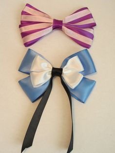 Alice and Chesire Cat themes hairbows @Bailey Francine Bortolin me and you for halloween?