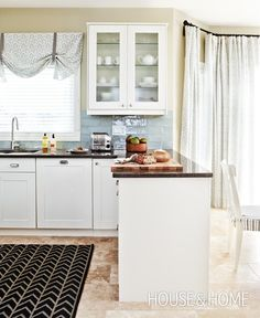 Spacious Neutral Kitchen | Designer: Cameron MacNeil | Photographer: Angus Fergusson | #kitchendesign #kitchencabinets #cabinetry #quartz #interiordesign